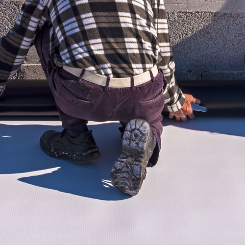A Roofer Installs Cool Roofing.